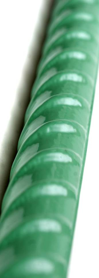a green epoxy coated rebar