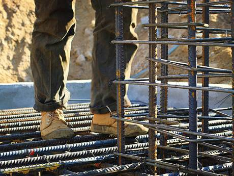A worker who is operating on high wears a pair of flat and anti-skid shoes.